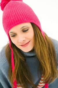 Shrink a wool beanie by felting the fibers in hot water.
