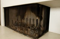 A cast-iron grate that is black and clean refreshes the look of a fireplace.