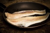 Two haddocks in frying pan