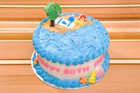 Coconut adds texture to a beach-themed 60th birthday cake.