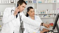 What Is the Difference Between a Pharmacy Tech Clerk & a Pharmacist?