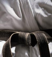 Colored belts represent levels of progress for students of martial arts. The system was pioneered in the 19th century by Dr. Jigoro Kano, considered ...