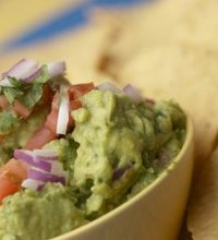 Snacking on guacamole may improve your heart health and reduce your risk of developing cancer. The combination of fats, fiber and antioxidants found ...