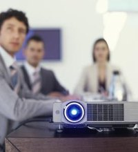 A projector displays your computer desktop onto a large screen, suitable for viewing by employees and other audiences. You can use the projector as ...