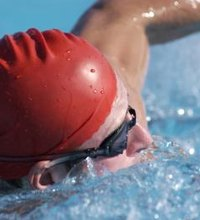 According to Mayo Clinic.com, a swimmer burns more than 400 calories during an hour swim. Distance events include longer swimming events such as the ...