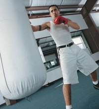 Punching a bag can provide a vigorous cardiovascular workout as well as tighten up your abs and strengthen your back muscles. If you have rounded ...