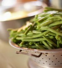 Green beans -- also called string beans -- have an edible pod and are either grown on bushes or attached to garden poles much like vines. Unlike many ...