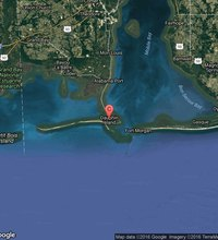 Dauphin Island, Alabama, is a quiet barrier island between the mouth of Mobile Bay and the Gulf of Mexico. The island has avoided build-up of tourist ...