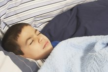 What to Do for Children Wheezing & Grunting While Sleeping