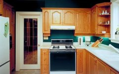 What Causes Discoloration of the Finish on Kitchen Cabinets?