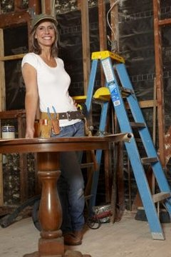 An unsafe worker: no safety glasses, no hard hat, no hearing protection.
