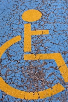 Handicapped parking space are marked on the pavement.