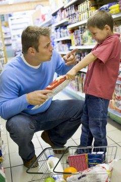 Dad reprimanding son