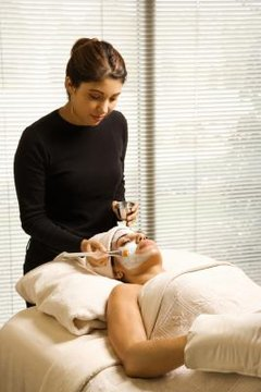 Cosmetologists may work in a spa, applying facials and other skincare products.