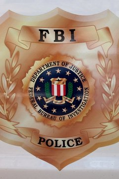 A seal of the Federal Bureau of Investigation. The Bureau's Special Agents carry badges.
