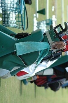 Players carry golf accessories in additon to clubs, balls and tees.