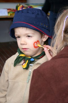 Face painting is a popular activity at school carnivals