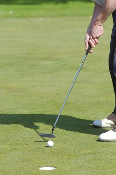 Use trial and error to determine where to place the ball in your stance and how far away to stand.