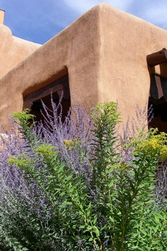 Adobe houses grow in wet air and shrink in dry air.