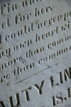 Etching or sandblasting removes material to form letters and designs on headstones.