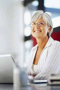 mature woman sitting in front of a laptop