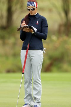 Michelle Wie makes a note in her yardage book during practice prior to the 2011 Solheim Cup.