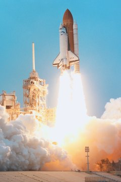 A rocket's exhaust produces thrust, accelerating the spacecraft.