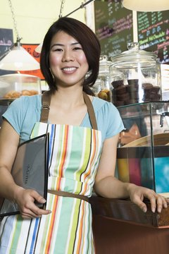 Smiling waitress in coffee shop