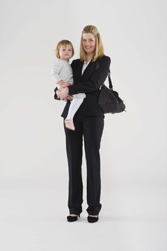 Businesswoman mother holding daughter