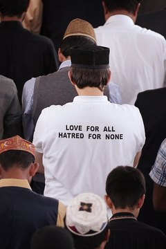 A  prayer for peace on a t-shirt reflects the feelings of a worshiper in a mosque.