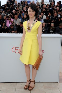 Actress Marta Gastini grounds a little yellow dress with chunky sandals at the Cannes Film Festival in 2012.
