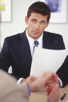 Businessman conducting interview in office