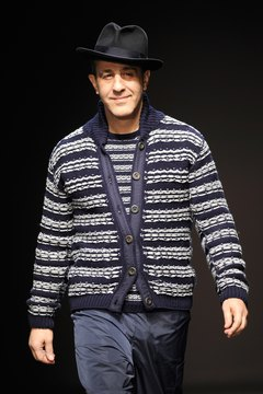 Pair your striped campus cardigan with a modern accessory like a fedora to give it a funky look.