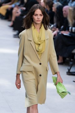 Plaids or brights are more typical, but a Burberry Prorsum model shows that pale pastels can work, too.