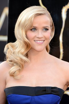 Side finger waves like Reese Witherspoon's complement an elegant outfit without being overpowering.
