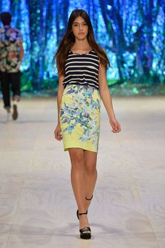 A model rocks a floral skirt with a striped top at the 2013 Mercedes-Benz Fashion Festival in Sydney, Australia.