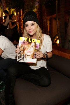 Actress Ashley Benson celebrates NYLON in a black beanie.