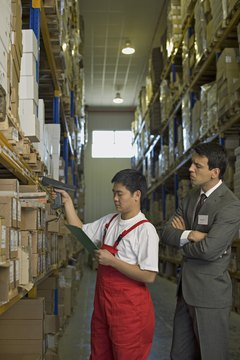 Businessman and worker in warehouse