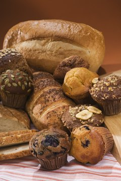 Whole-grain foods like brown bread can cause bloating.
