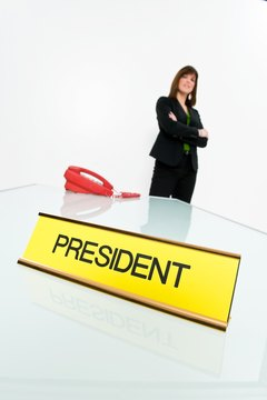 President nameplate on desk with woman posing