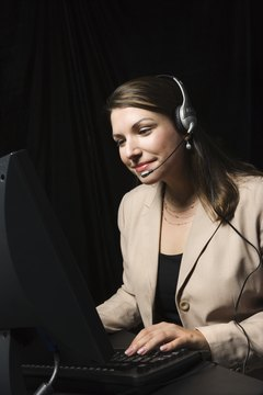 Woman wearing headset and using computer
