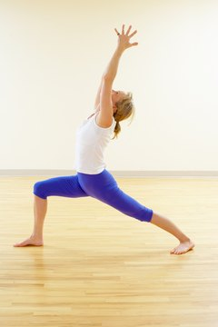 Warrior pose tones the leg muscles and increases mobility.