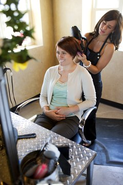 A cosmetologist can get to work with an AAS degree in hand.
