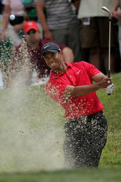 Tiger Woods blasts out of a bunker during the 2008 U.S. Open.