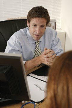 Businessman interviewing woman