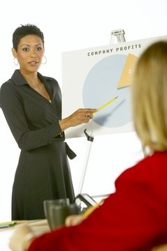woman pointing at graph