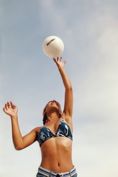 Beach volleyball is a great way to stay in shape in the sunshine.