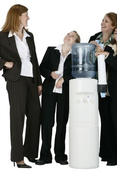 Businesswomen Talking by the Water Cooler