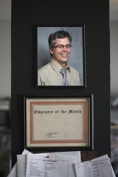 Employee of the month certificate with photo of man