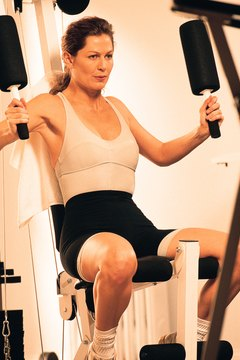 The peck deck machine allows you to do chair flyes using machine weights.